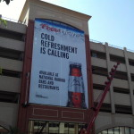 Large outdoor mesh banner for Coors Light installed at National Harbor