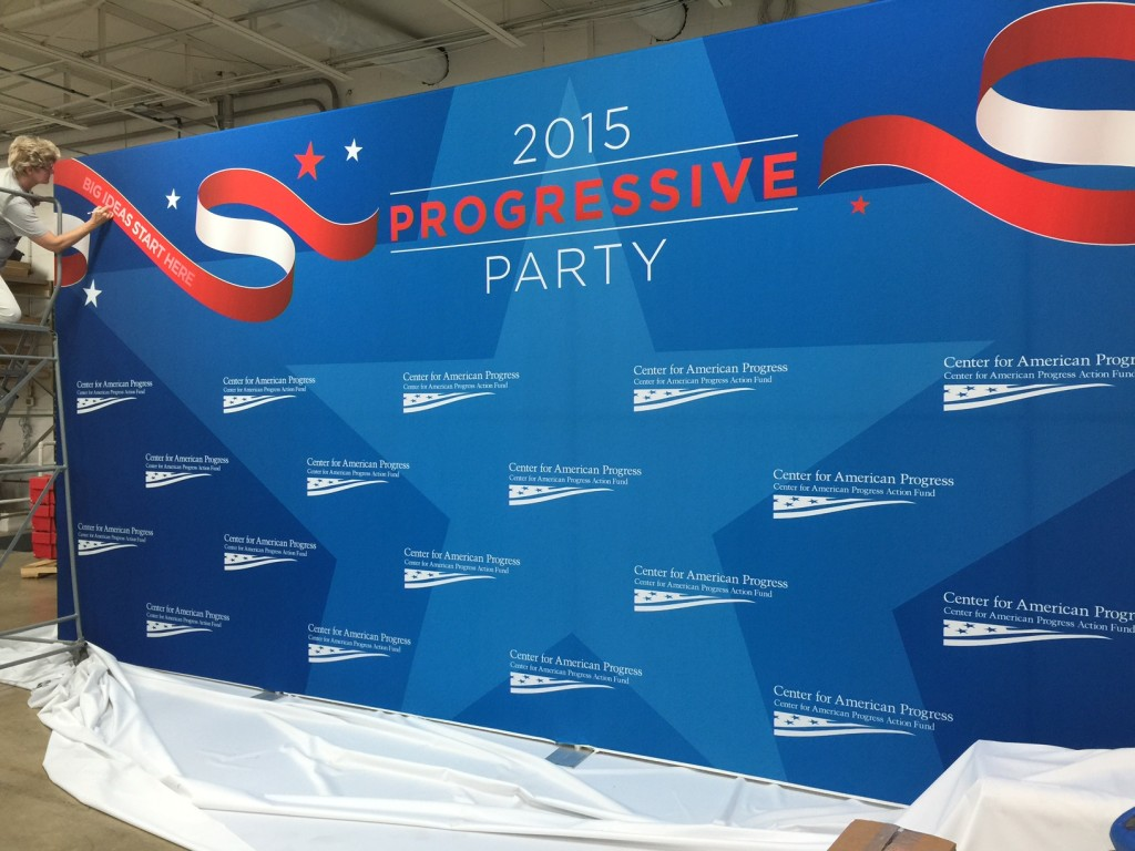 Huge 10' x 24' fabric step and repeat banner popup back wall for the Center For American Progress