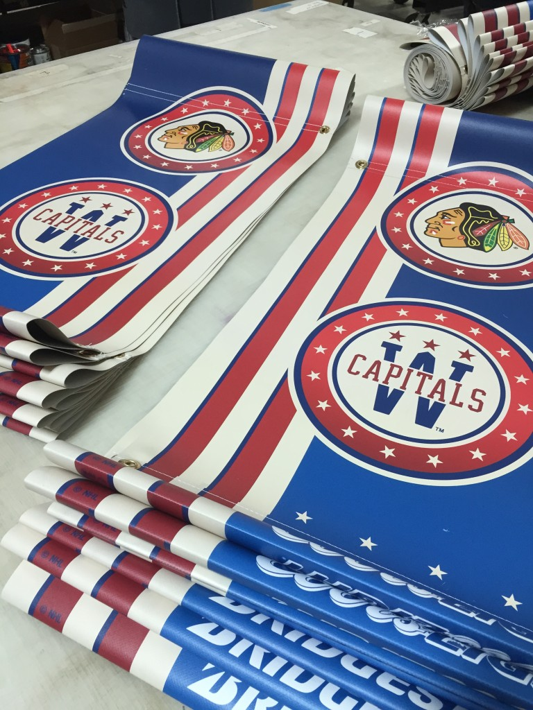 Pole banners produced by CSI for the 2015 NHL Winter Classic at Nationals Park stacked and ready for installation at our facility. Visit csi2.com for more information.