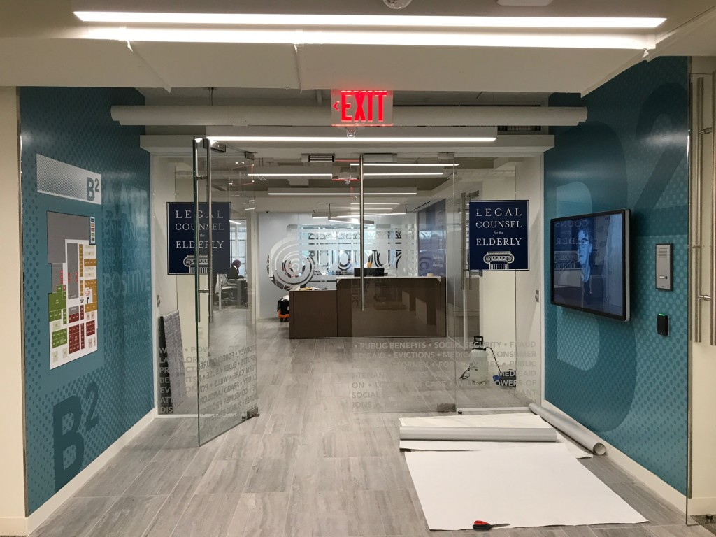 Interior Building Graphics - Adhesive vinyl wall mural, etchmark privacy cut vinyl, and printed decals produced and installed by CSI for AARP at their HQ in Washington, DC.