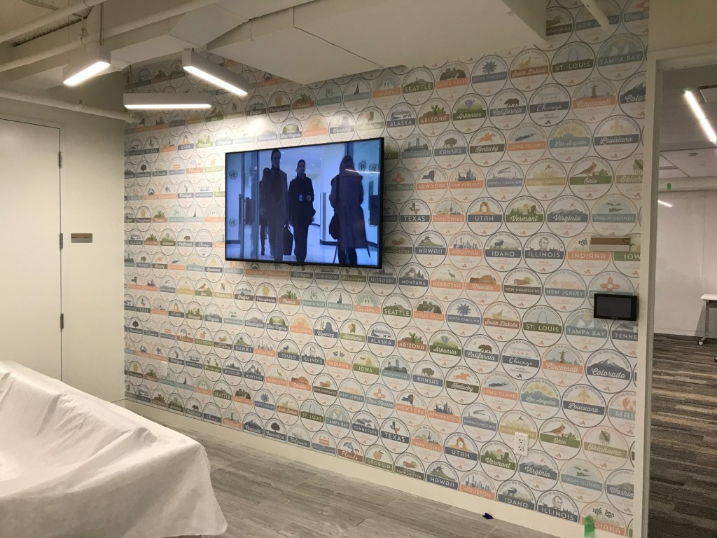 Interior Building Graphics - Adhesive vinyl wall mural produced and installed by CSI for AARP at their HQ in Washington, DC