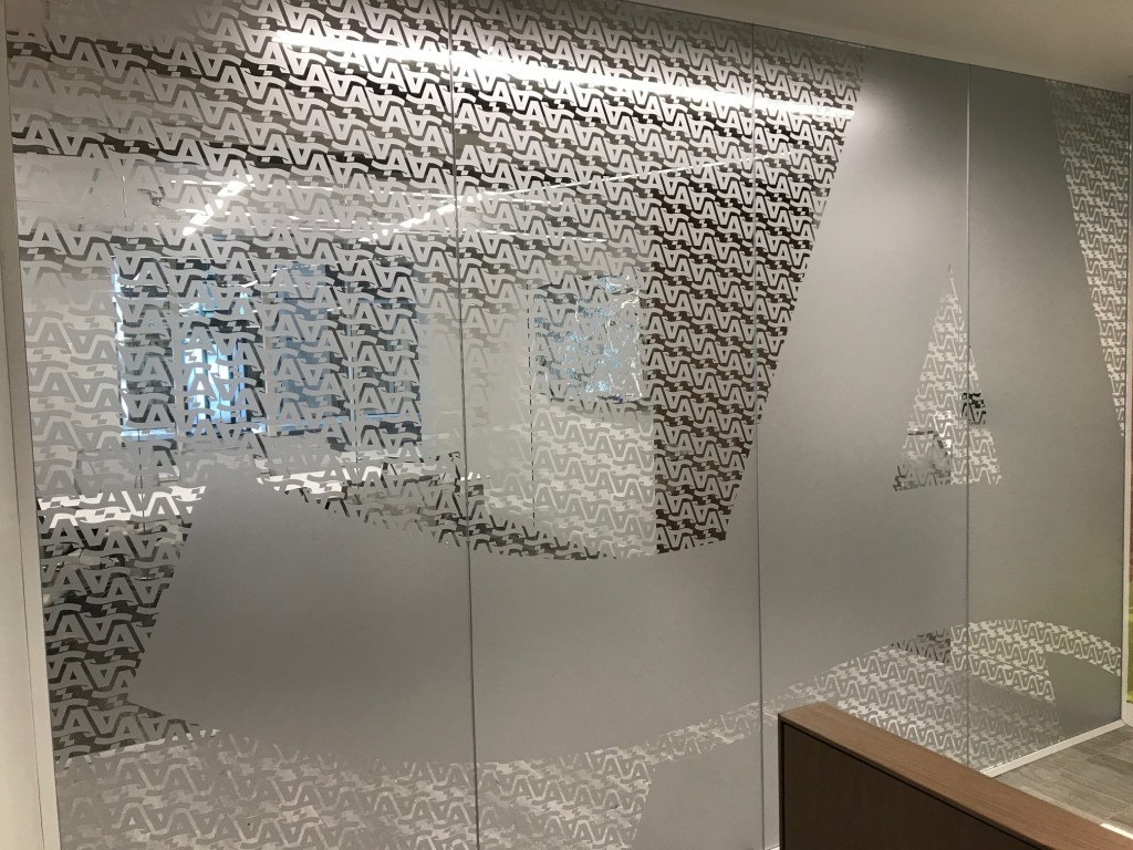Interior Building Graphics - Etchmark privacy cut vinyl produced and installed by CSI for AARP at their HQ in Washington, DC