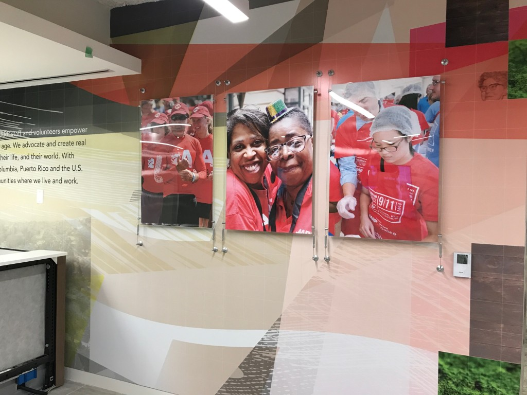 Interior Building Graphics - Adhesive vinyl wall mural & mounted photo prints produced and installed by CSI for AARP at their HQ in Washington, DC